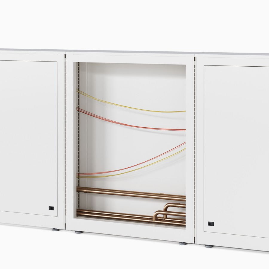 Co/Struc wall system with an open frame to show the copper piping and electrical wiring routing through the system.