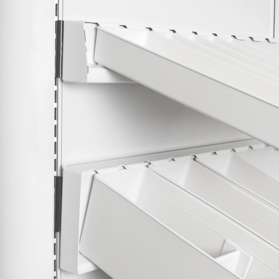 Close-up of Co/Struc panel with rail that has subcontainers attached for organization.