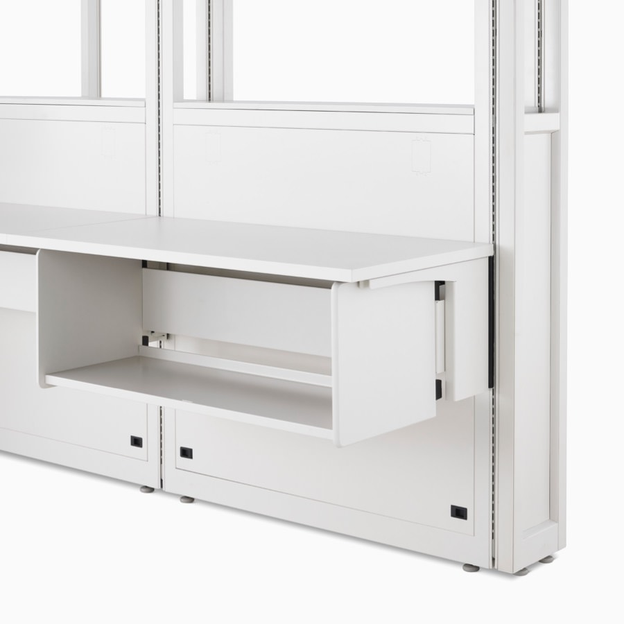 Detail of soft white Co/Struc System frame module, work surface, and B-Style storage shelf hanging on an adapter rail under the surface.
