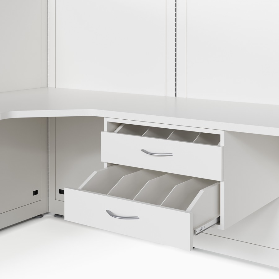 A close-up detail of a Co/Struc bottle drawer with two drawers and attached under a work surface that's attached to a wall frame in a soft white finish.