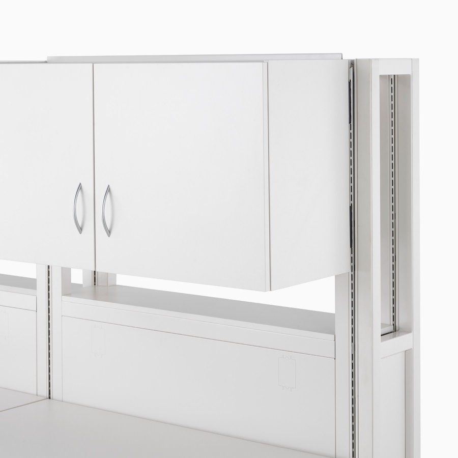 Detail of soft white Co/Struc frame module with double-door closed upper storage unit.