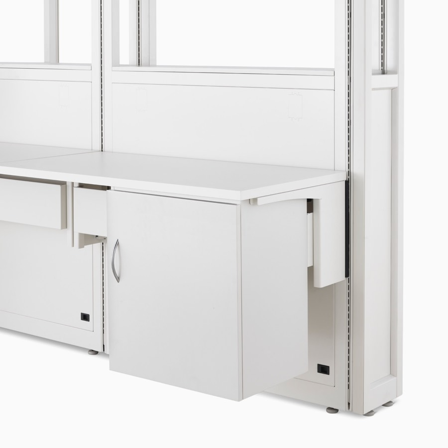 Detail of soft white Co/Struc System frame module, work surface, and storage unit hanging on an adapter rail under the surface.