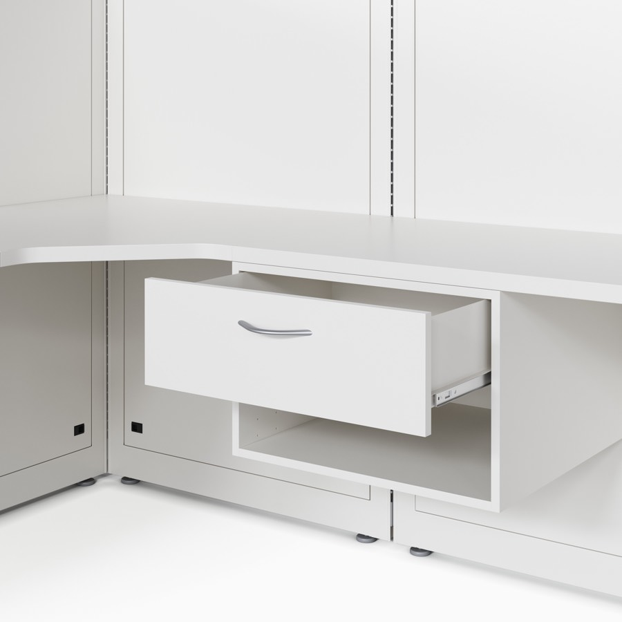 Co/Struc case drawer and storage unit attached under a work surface that's mounted to a wall frame in a soft white finish.