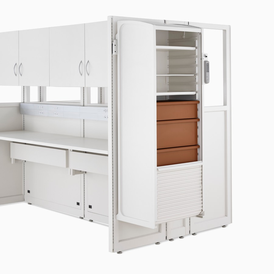 Detail of soft white Co/Struc System frame module with hanging locker with terra cotta drawers.
