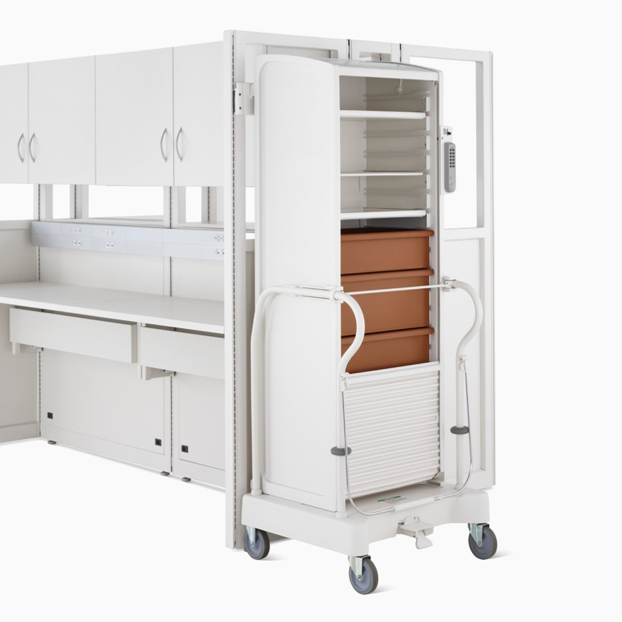 Detail of soft white Co/Struc System locker with terra cotta drawers on a TR3 transport cart.