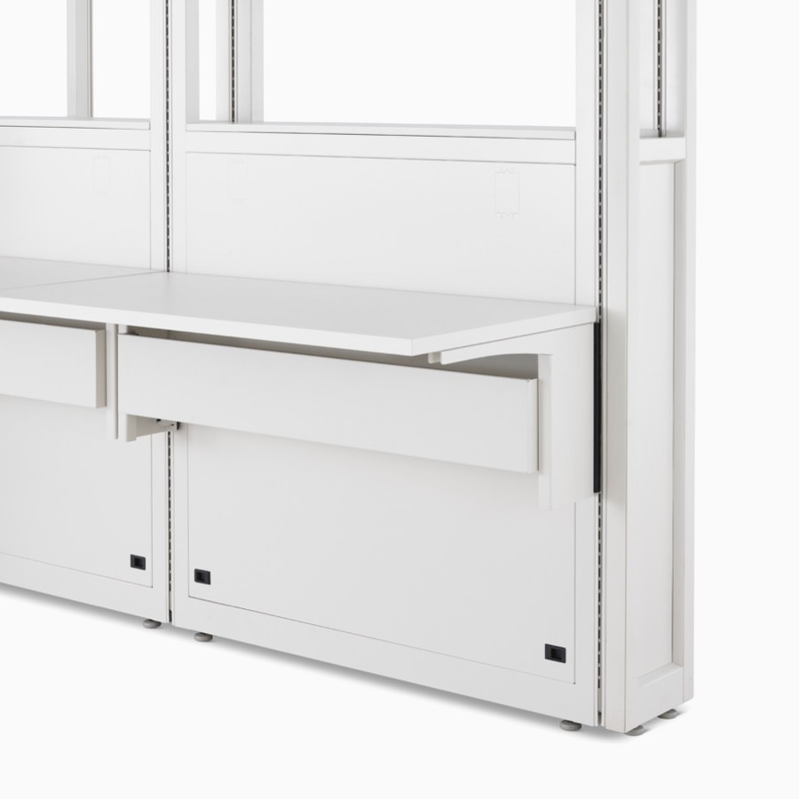Detail of Co/Struc System in soft white finish featuring frame module with adapter rail under the work surface.