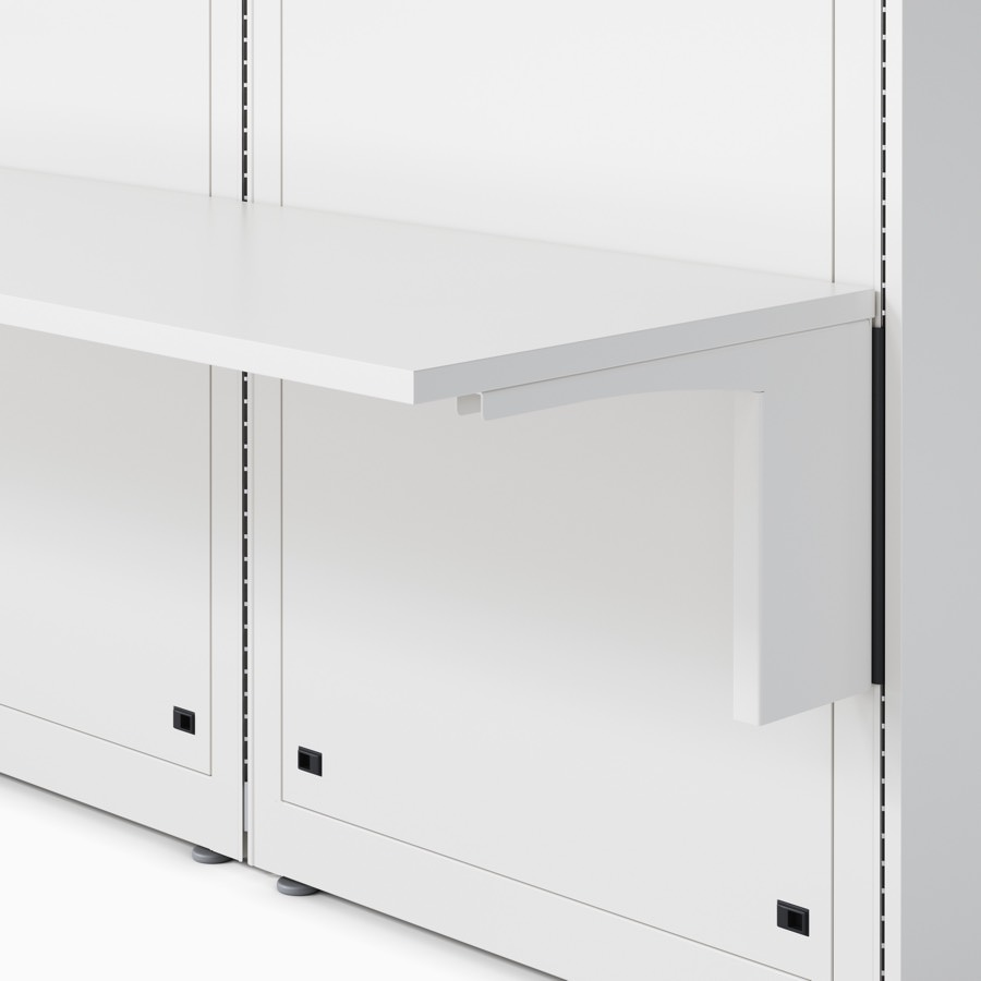 Co/Struc wall with an attached work surface and surface support in a soft white finish.