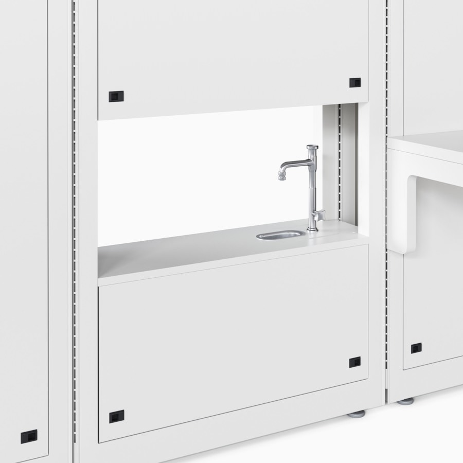 Co/Struc lab module in a soft white finish with an opening in the module that contains a cup sink and faucet.