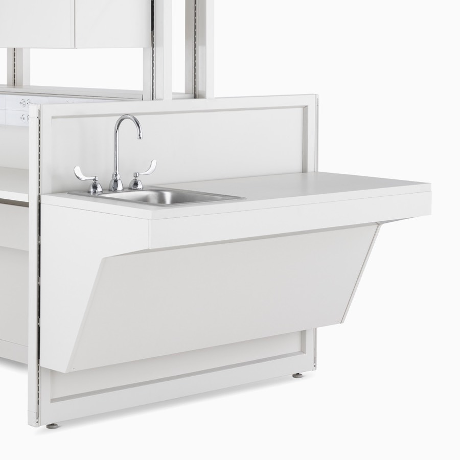 Detail of soft white Co/Struc System ADA sink hanging on a frame module.