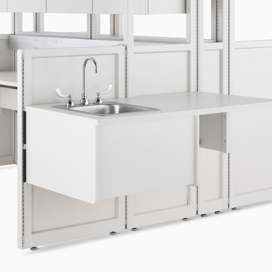 Detail of soft white Co/Struc System frame module with attached sink.