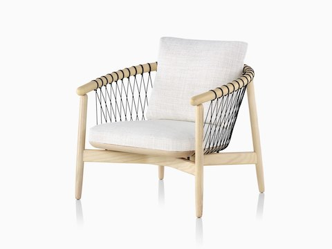 Cream Crosshatch Chair with blonde frame, viewed from the front at an angle.