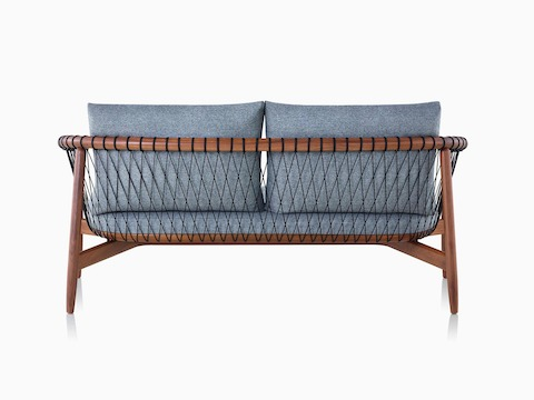 A dark-coloured Crosshatch Settee featuring grey upholstery and a walnut frame.