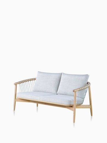 A light-coloured Crosshatch Settee featuring grey upholstery and a white ash frame. Select to go to the Crosshatch Settee product page.