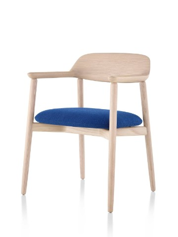 Crosshatch Side Chair with a light finish and blue seat cushion, viewed from a 45-degree angle.