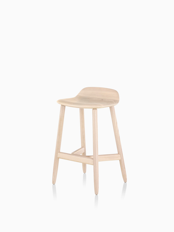 Crosshatch Stool in a light wood finish. Select to go to the Crosshatch Stool product page.