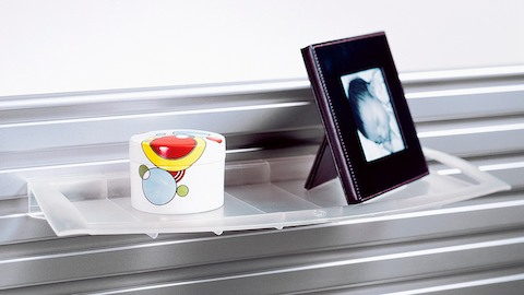 A Display Tray attached to a tool rail holds a photo and colorful round box.