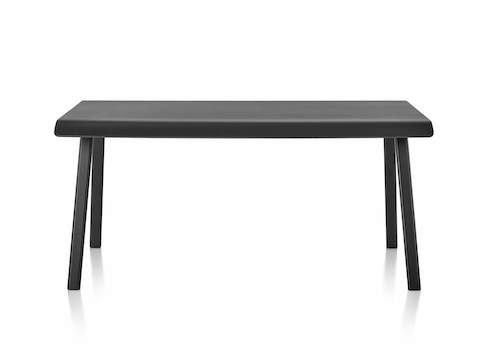 Distil Table from Herman Miller in black with molded plywood top and solid wood legs, front view.