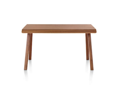 Herman Miller Distil Table in medium wood tone with molded plywood top and solid wood legs, front view.