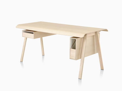 Three quarter view of Distil Desk from Herman Miller in light natural wood with drawer and organizer.