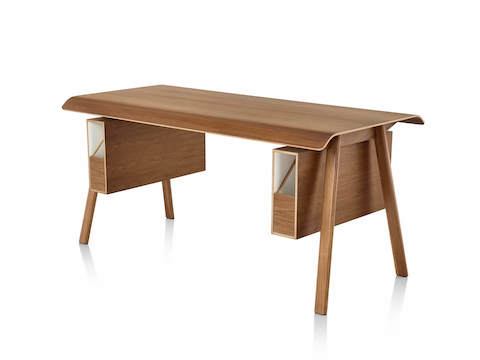 Angled view of Herman Miller Distil Desk in medium wood with dual desk organizers and molded plywood top.