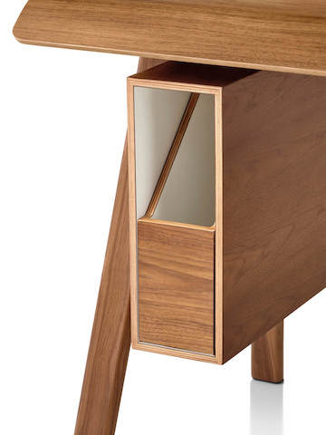 Herman Miller Distil Desk in medium wood tone, detail shot of organizer on home office desk.
