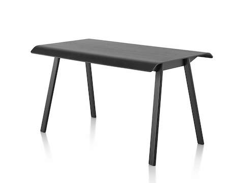Angled view of a black Distil table.