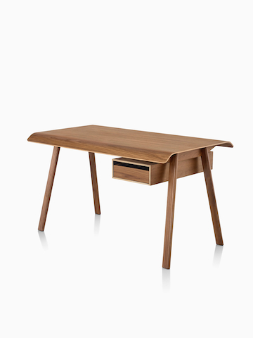 A Distil Desk in a medium wood finish. Select to go to the Distil Desk and Table product page.