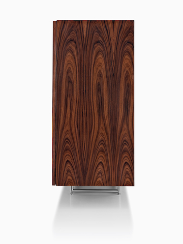 Side view of a Domino Storage sideboard, focusing on the rich wood finish.