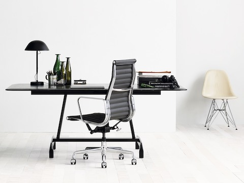 Small office with a black Eames Aluminum Group Chair black AGL table ... : herman miller aluminum group chair - Cheerinfomania.Com