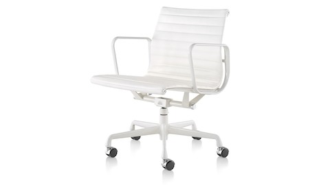 White leather Eames Aluminum Group mid-back management chair with a five-star base and powder coat frame.