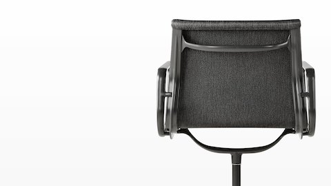 Rear view of a black Eames Aluminum Group outdoor chair, focusing on the proprietary Outdoor Weave fabric.