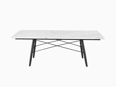 A rectangular Eames Coffee Table with black legs, metal cross-struts, and a white marble top, viewed from the long side.