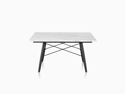 A square Eames Coffee Table with black wood legs, metal cross-struts, and a white marble top.