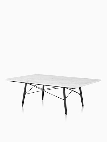 A rectangular Eames Coffee Table with a white top. Select to go to the Eames Coffee Table product page.