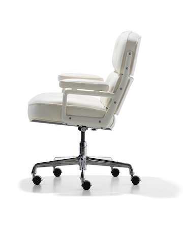 Profile view of a white leather Eames Executive Chair.