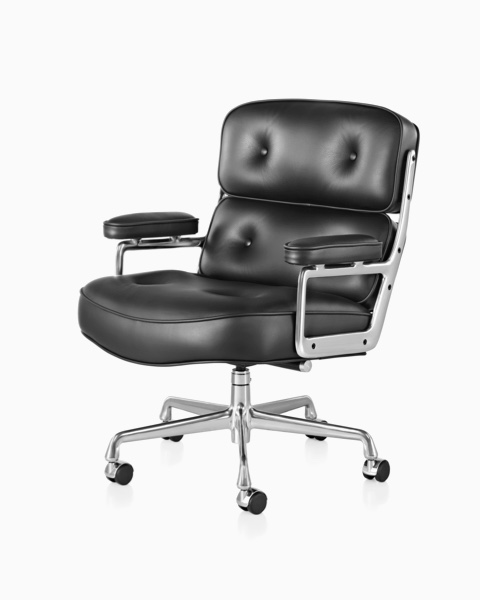 Black leather Eames Executive Chair, offering a close view of the thickly cushioned seat, back, and arms.