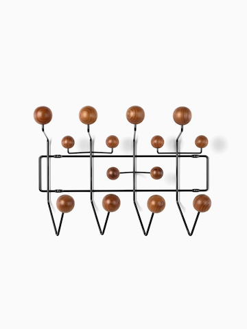 An Eames Hang-It-All storage rack with wood knobs.