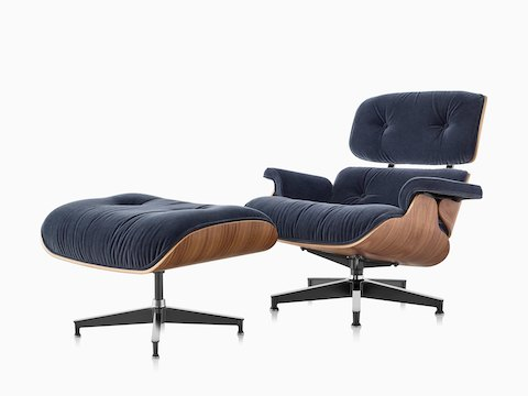 Eames Lounge Chair and Ottoman with blue mohair upholstery and a wood veneer shell, viewed from a 45-degree angle.