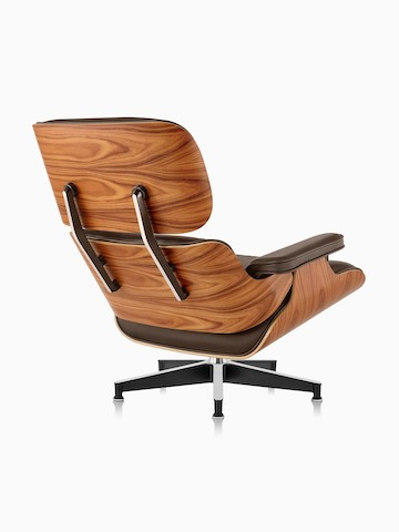 Three Quarter Rear View Of A Brown Leather Eames Lounge Chair With A Wood  Veneer ...