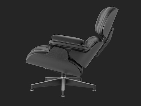 Profile view of a black leather Eames Lounge Chair with a black shell.
