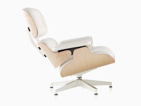Profile view of a white leather Eames Lounge Chair with a white ash veneer shell.