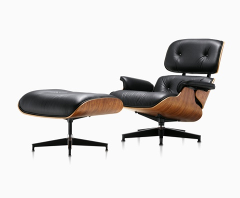 Black Leather Eames Lounge Chair And Ottoman With A Wood Veneer Shell,  Viewed From A