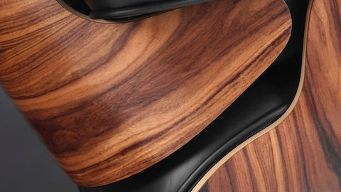 Close-up of the 7-ply veneer shell on an Eames Lounge Chair.