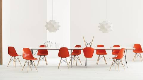 Collaboration space featuring Eames Molded Fiberglass stools and armchairs, both red and blue.