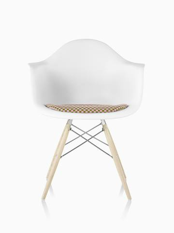 Brown Eames Molded Fiberglass side chair with a stacking base, viewed from a 45-degree angle.