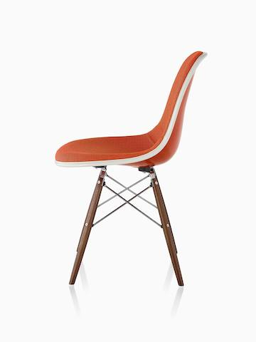 White Eames Molded Fiberglass side chair with a dowel base, viewed from a 45-degree angle.