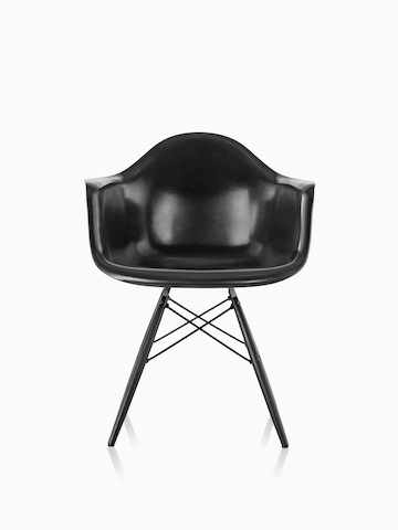 Black Eames Molded Fiberglass armchair with dowel legs, viewed from the front.