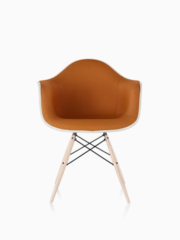 Orange Eames Molded Fiberglass armchair with full upholstery and dowel legs, viewed from the front.