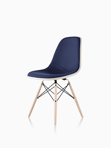Blue upholstered Eames Molded Fiberglass side chair with dowel legs, viewed from a 45-degree angle.