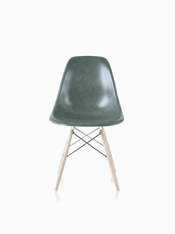 An Eames Molded Fiberglass Side Chair with a dowel base and dark green seat.